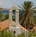 Chapel and palm tree in Loutro
