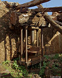 Old olive press in a ruined house in Aradena