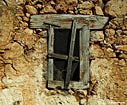 Window of a ruined house in Aradena