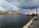 Dark clouds over Chania harbour