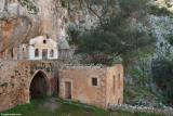 The monastery of Katholiko . Note the huge olive tree growing out of the ruined building. It has not been pruned for over a 100 years.