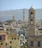 Chania rooftops with the chirch tower of the cathedral (foreground) as well as the church tower of Agios Nikolaos and its minaret further back