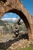 The White Mountains seen through the arch of a ruined house in the abandoned village of Aradena