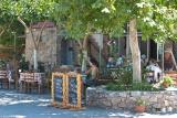 Platanos Café, Restaurant and Rooms for rent is located right opposite the statue of Daskalogiannis and within shouting distance of the school, the church and its cemetery and the town hall, the way all good cafés on any self-respecting village square should be