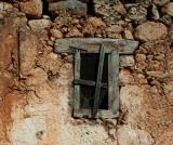 The window of a ruined house in the village of Aradena